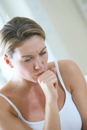 coughing: Middle-aged woman having a cold and coughing