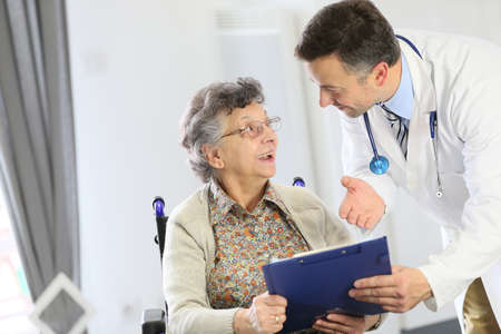 medicalcare: Doctor with elderly woman in nursing home