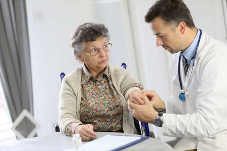 medicalcare: Doctor checking blood pressure to elderly woman Stock Photo