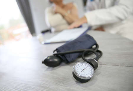 medicalcare: Blood pressure medical equipment set on table Stock Photo