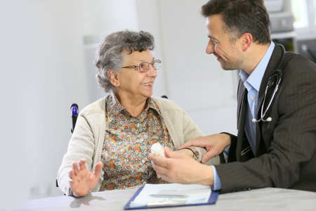 medicalcare: Doctor visiting elderly patient at home