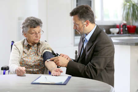 medicalcare: Doctor visiting elderly woman at home