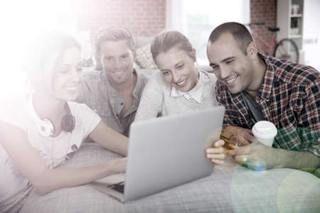 shared sharing: Group of friends having fun making a video call Stock Photo