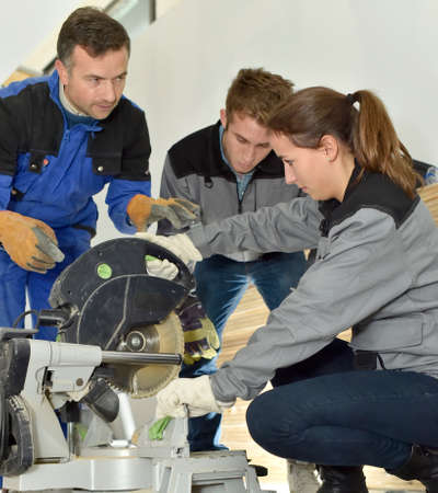 Trainees learning how to use ceramic saw photo