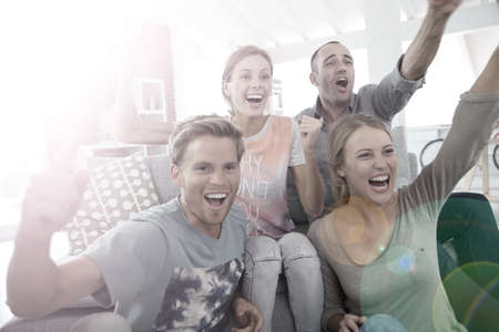 football world cup: Roommates in apartment watching football game