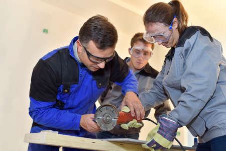 stone cutter: Students learning how to use ceramic saw