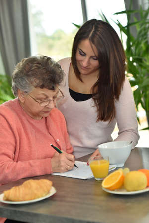 crosswords: Young woman visiting elderly woman in nursing home