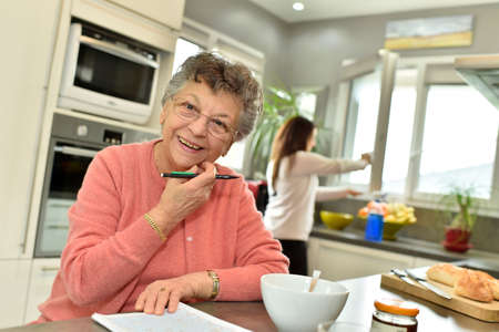homecare: Smiling elderly woman at home with homecare