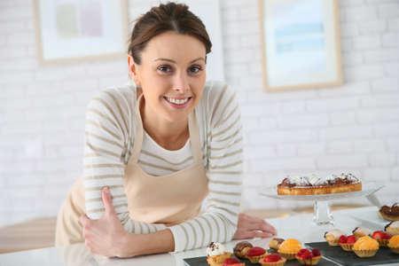 Portrait of smiling bakery shop tender