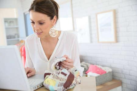 shopgirl: Beautiful shopgirl working in clothing store