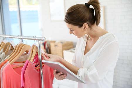 shopgirl: Shop woman preparing summer sales in store
