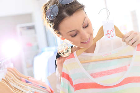 Beautiful woman in clothing storesduring summer sales photo