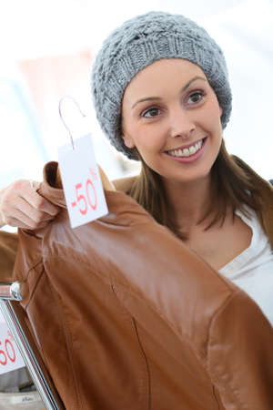 clothing store: Portrait of stylish woman in clothing store