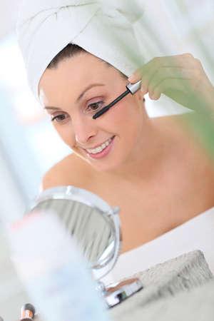 beautycare: Beautiful woman applying mascara Stock Photo