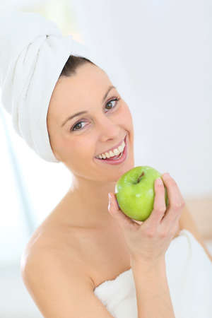 beautycare: Beautiful woman holding green apple