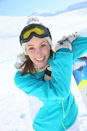 winter vacation: Woman in ski outfit standing at top of mountain Stock Photo