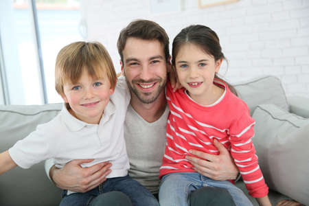 single father: Portrait of cheerful daddy with kids