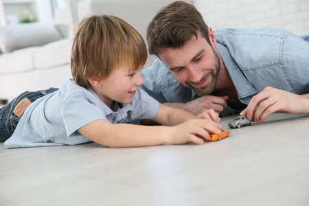 boys toys: Daddy with little boy playing with toy cars