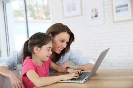 parental control: Mother and daughter playing on laptop computer