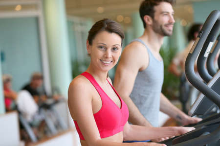 fitness center: Couple doing cardio training program in fitness center