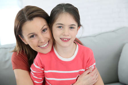10 years old: Portrait of mother and daughter with red shirt