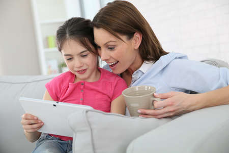 parental control: Mother with little girl websurfing on tablet