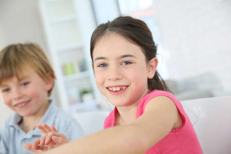 10 years old: Cheerful brunette school girl with pink shirt