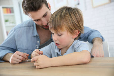 parental control: Daddy and son playing with smartphone