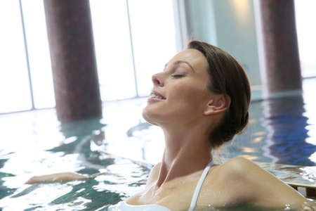 thalasso: Woman relaxing in seawater spa pool
