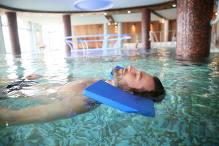 retraining: Man in spa pool doing exercises for muscular recovery