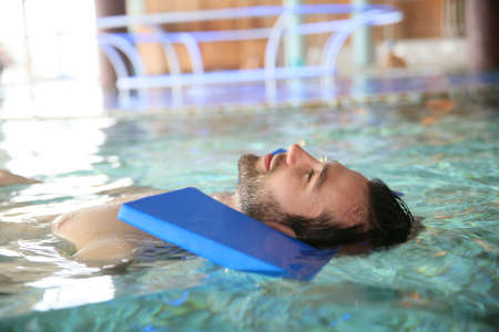 neuromuscular: Man in spa pool doing exercises for muscular recovery