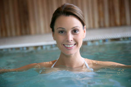 salt water: Beautiful woman relaxing in spa swimming-pool Stock Photo
