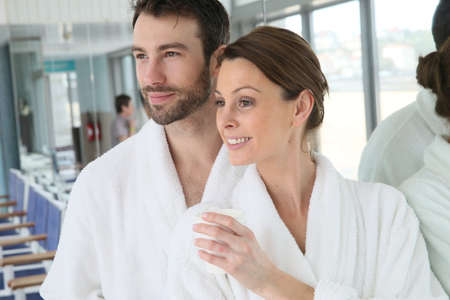 thalasso: Portrait of couple in bathrobe spa center relaxation room
