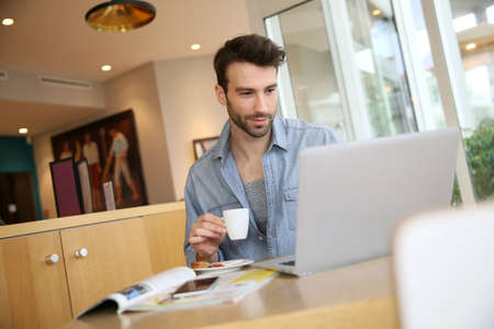 Man working on laptop computer from home