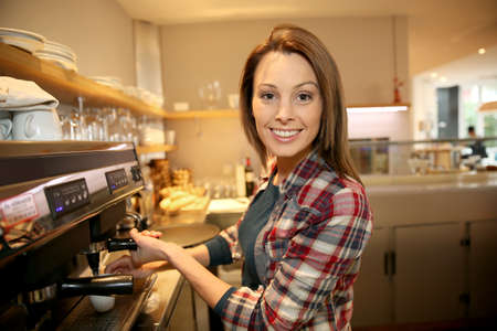coffeeshop: Coffeeshop keeper preparing expresso Stock Photo