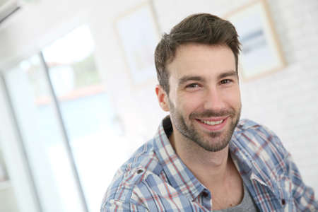 man with camera: Portrait of cheerful 30-year-old man Stock Photo