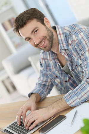 officeworker: Portrait of smiling home-office worker Stock Photo
