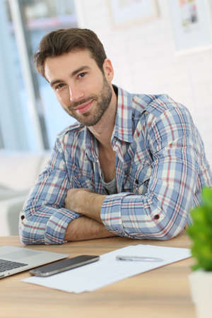 company person: Portrait of smiling home-office worker Stock Photo