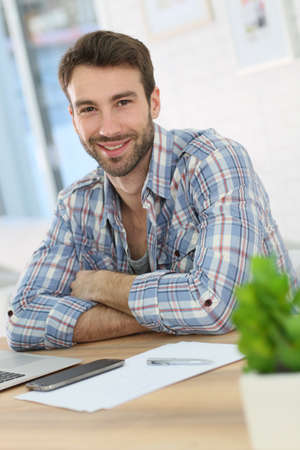 websurfing: Portrait of smiling home-office worker Stock Photo