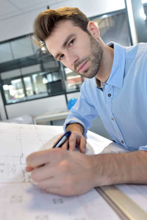 drafting: Architect designing on drafting table Stock Photo