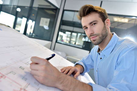 drafting table: Architect designing on drafting table Stock Photo
