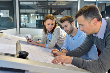 Team of architects working on construction project Stock Photo