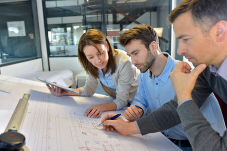 Team of architects working on construction project Stockfoto