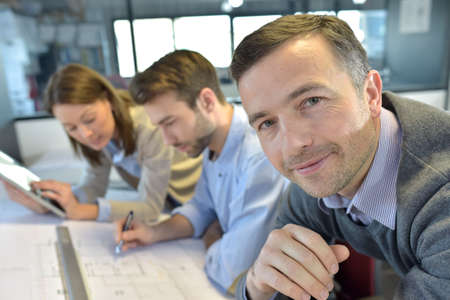 amongst: Portrait of architect amongst group in meeting Stock Photo