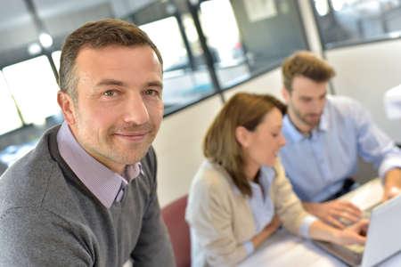 attending: Businessman attending meeting with workteam