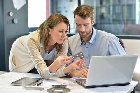 Engineers in industrial sector working in office photo