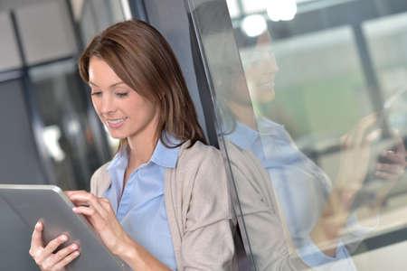 websurfing: Businesswoman websurfing on digital tablet