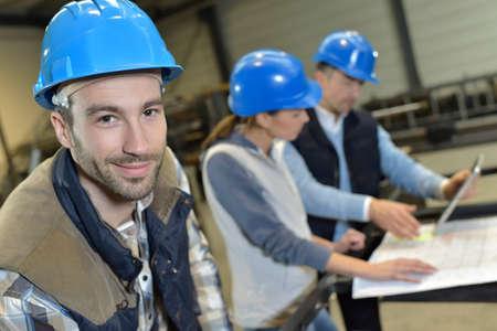 engineer: Portrait of cheerful industrial engineer