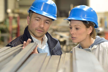 supplier: Supplier with engineer checking on production in factory