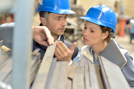 mechanical men: Supplier with engineer checking on production in factory